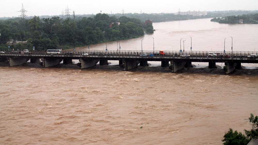 <p>Heavy downpour for the last few days has caused the Swarnarekha river in Jamshedpur to swell above normal.Image showing Mango bridge over the Swarnarekha river.</p>