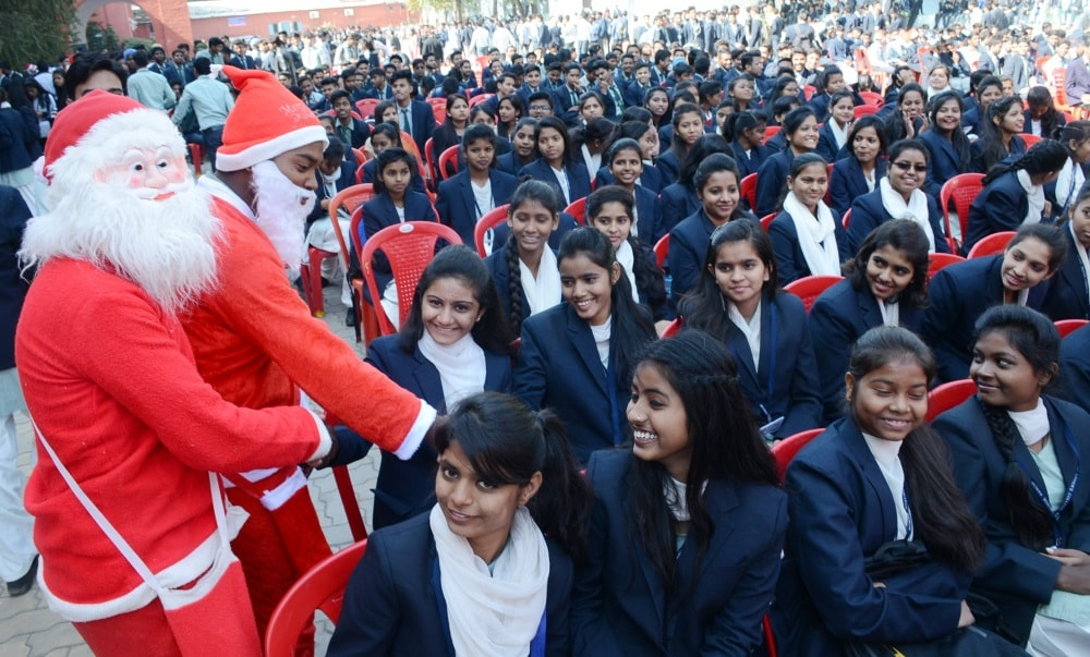 <p>Santa Claus distributes gifts among the college students during Christmas Gathering at St. Xavier's college in Ranchi on Wednesday.</p>