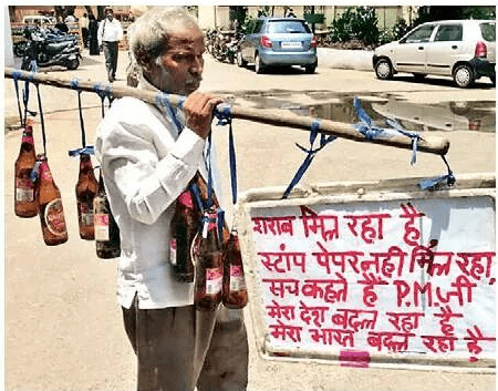 <p>Booze are available,stamp paper not available.As a result,a farmer who has been struggling to buy one stamp paper,preferred to walk with liquor bottles in Jamshedpurin protest,an…