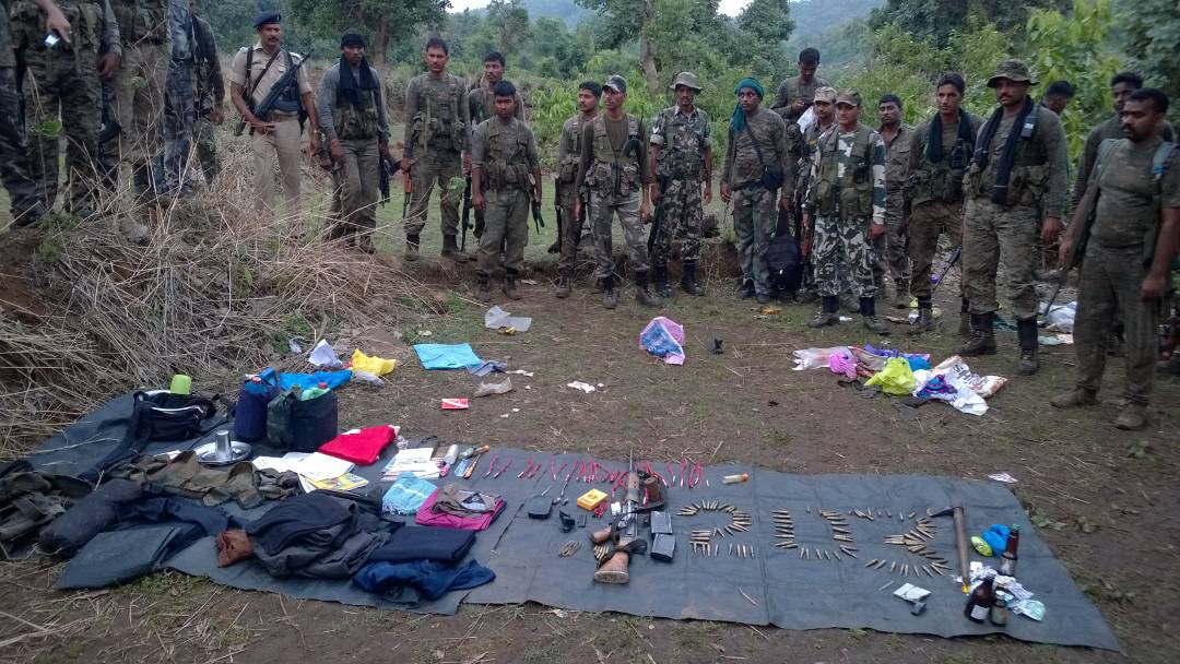 <p>District police personnel, Jharkhand Jaguar (JJ), Cobra battalion and CRPF jawans stand near displaying arms ammunitions, Naxal dresses, Posters and other items  recovered…