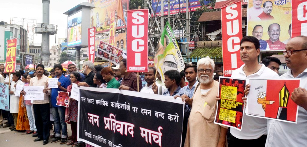 <p>Economist and Civil rights activist Jean Dreze along with others activists holds placards during 'Jan Prativad March' at Albert Ekka Chowk in Ranchi on Thursday. </p>…