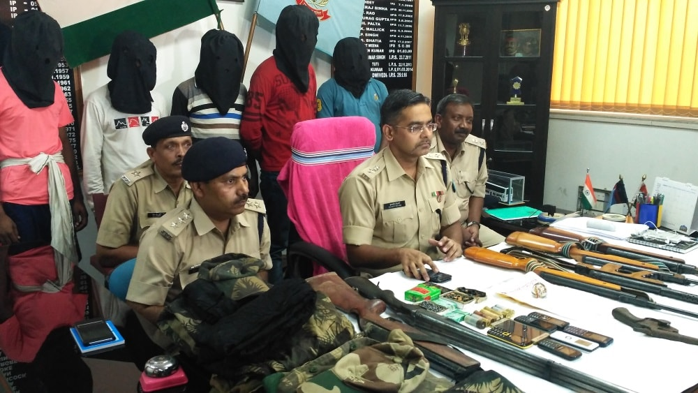 <p>Ranchi Police headed by SSP Kuldeep Dwivedi(second from left) arrested Maoists and recovered many arms and ammunition as well as clothes and equipments.</p>