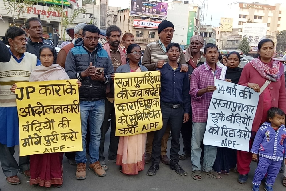 <p>All India People's Forum activists hold placards demonstrating for the release of prisoners who have completed 14 years in prison, at Albert Ekka Chowk in Ranchi on Thursday.</p>…