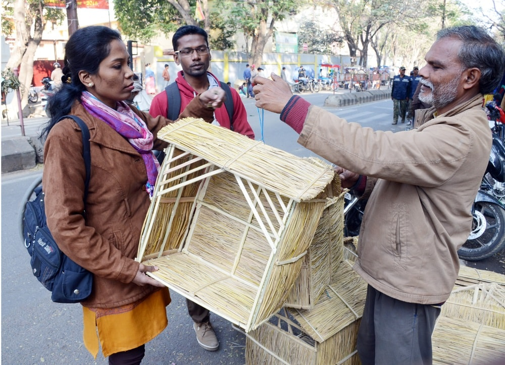 <p>A girl buying 'Charni' house of Jesus at a roadside market ahead of Christmas festival in Ranchi on Wednesday.</p>