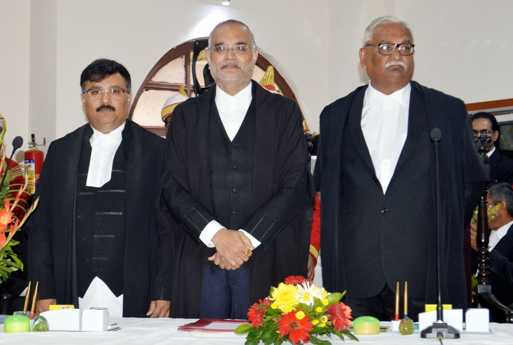 <p>Chief Justice Jharkhand High Court Justice DN Patel alongwith Newly appointed Judges Justice  Ananda Sen (L),  Justice Anant Vijay Singh (R)after oath taking ceremony…
