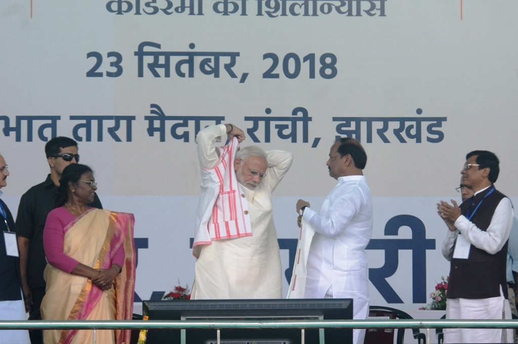 "<p>Prime Minister Narendra Modi being presented a traditional boundi by Jharkhand Chief Minister Raghubar Das during the launching ceremony of ""Ayushman Bharat"" health scheme…"