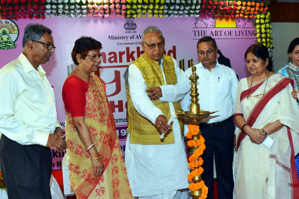 <p>Minister of Health and Family Welfare, Ramchandra Chandravanshi lighting the lamp during the inaugural ceremony of three days 'Yoga Mahotsav' at IAS club in Ranchi on Friday. State…