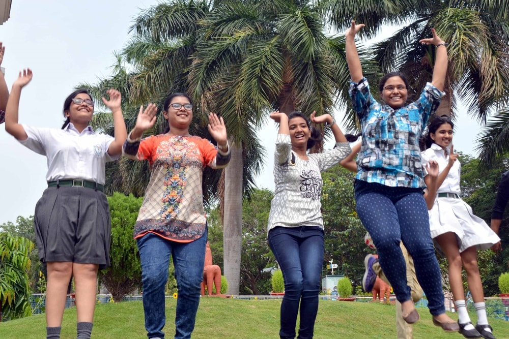 <p>Students of DPS celebrate their success in the CBSE class 12thresults at their school premises in Ranchi on Saturday.</p>