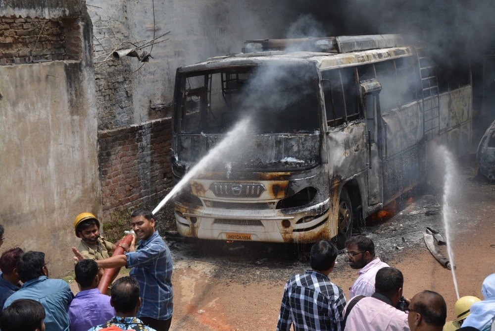 <p>Fire fighter dousing a major fire that broke out on a bus at a busy road Mallah toil of Hindpirhi in Ranchi on Saturday.</p>