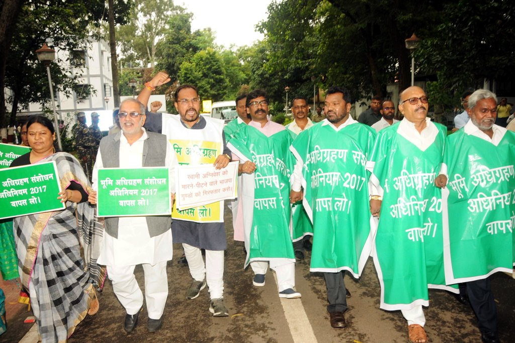 <p>JMM Executive president and Opposition leader Hemant Soren along with all Opposition parties leaders hold placards during a protest march outside Assembly against the Land Acquisition…