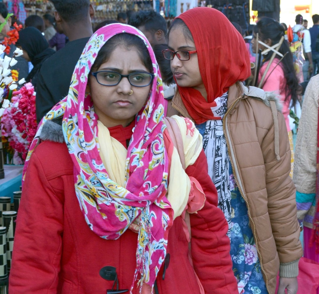 <p>Women wearing woolens, visit the ongoing National Khadi and Saras Mela 2017-18 during a cold day in Ranchi on Saturday.</p>
