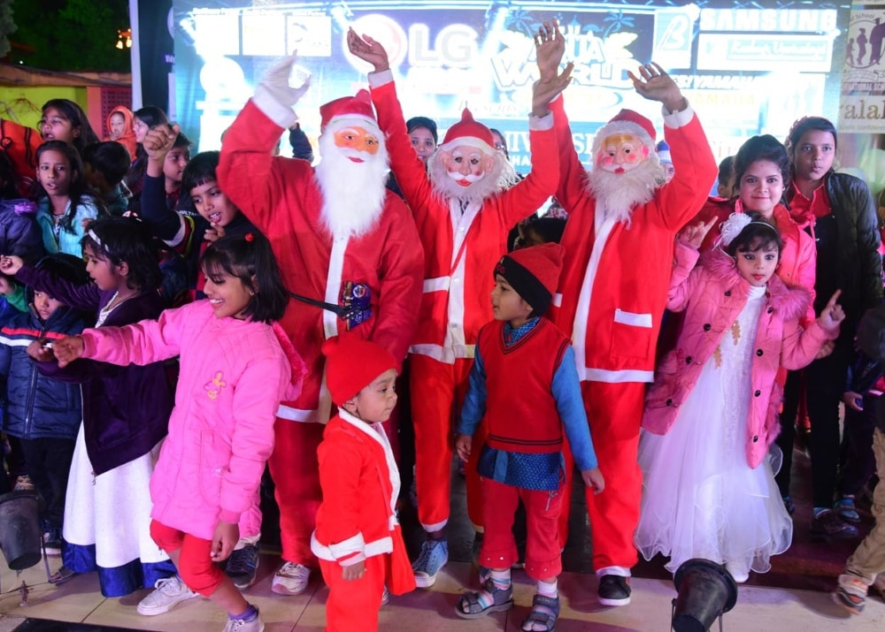 <p>Children dressed as Santa Claus participating at a  dance competition at Aqua World on the occasion of Christmas festival in Ranchi on Monday.</p>