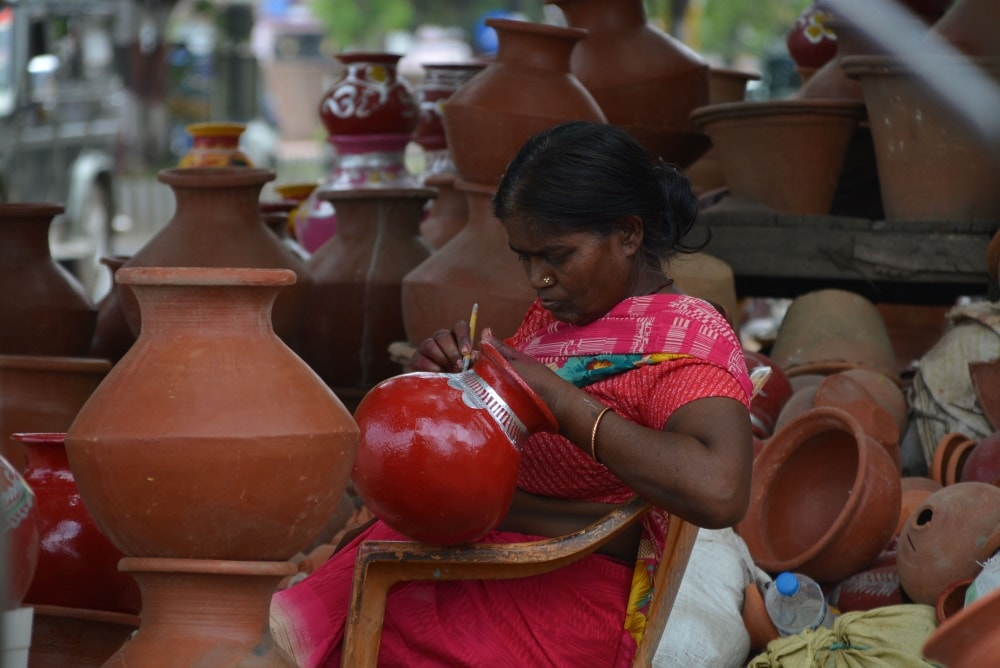 <p>Even while the summer is out and monsoon has set in, women are busy giving finishing touches to the earthen pots for sale on roadside shop in Ranchi on Monday.</p>