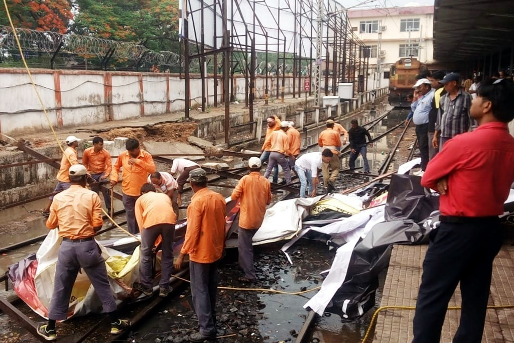 <p>Railway gangman clean railway track after a huge poster fell into the railway tracks during a heavy storm and rain, at Ranchi- Lohardaga-Tori railway line in Ranchi on Saturday. </p>…