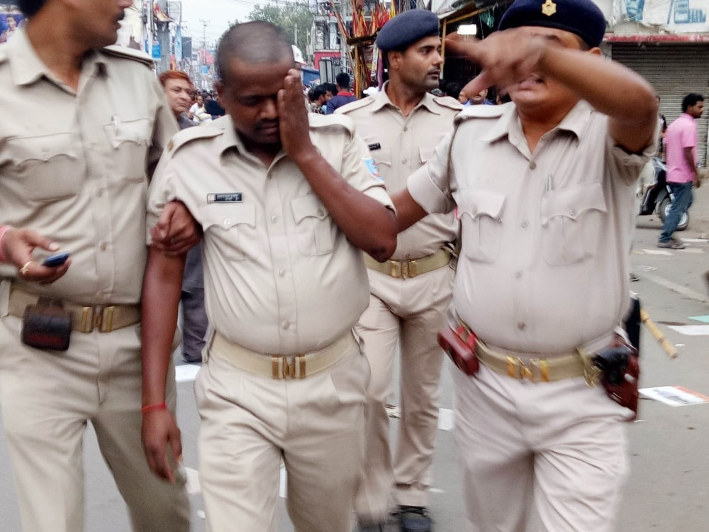 <p>An injured policeman being taken for treatment after a violent clash between two communities in Ranchi on Sunday.</p>