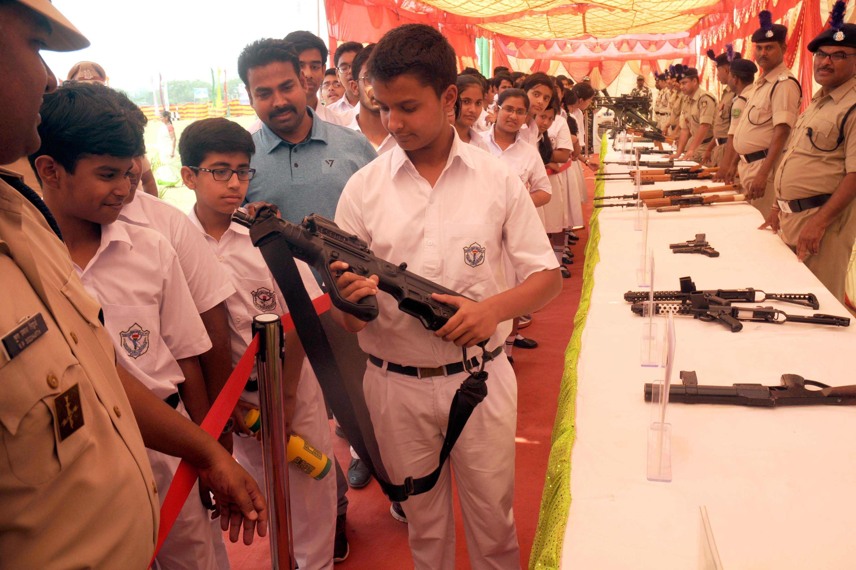 <p>A CRPF official explained the use of arms and ammunition used by the forces in different situations and locations to school children, during an exhibition on the occasion of the…