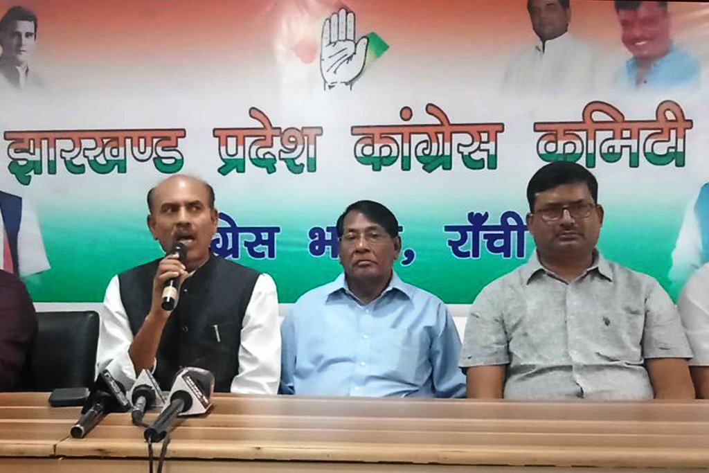 <p>Former Minister and senior Congress leader KN Tripahti addresses a press conference at the party office in Ranchi on Friday.</p>