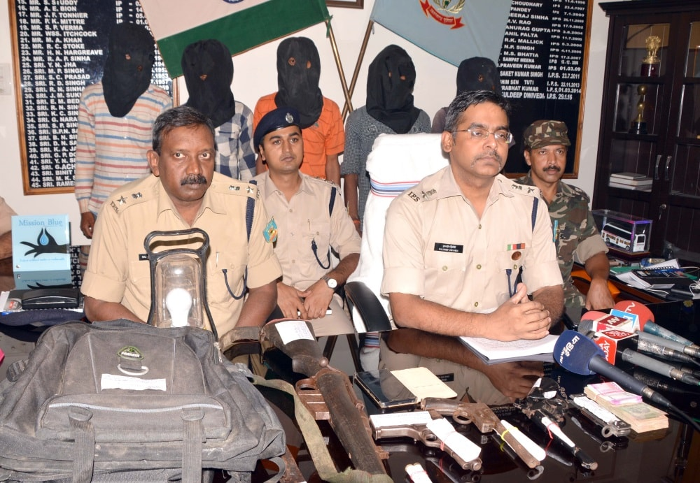 <p>Ranchi SSP Kuldeep Dwivedi  along with Rural SP Rajkumar Lakra and senior officers during a press conference at his office in Ranchi on Thursday, displaying weapons and…