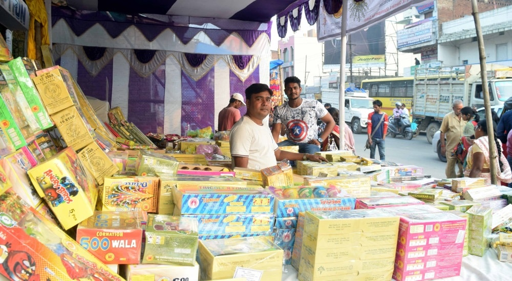 <p>Shopkeepers selling firecrackers doing brisk business on the eve of Diwali- the festival of lights.</p>