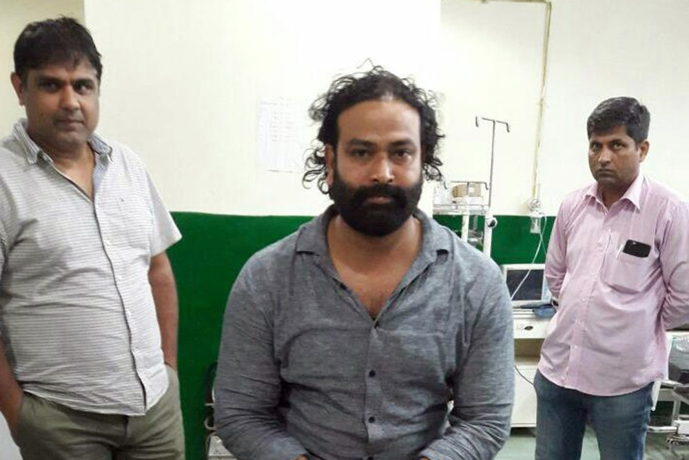 <p>Gangster Akhilesh Singh being treated at a hospital after he was arrested by a joint team of Haryana and Jharkhand police teams at Gurugram in Haryana following an encounter…