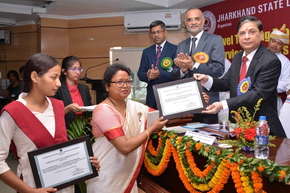 <p>Supreme Court Judge and Executive Chairman of NALSA,Justice Deepak Misra handed over a certificate to a teacher for Legal Literacy Club during  the State level training programme…