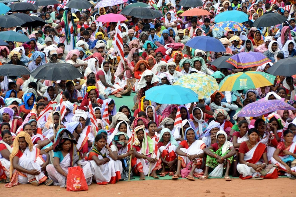 <p>People of tribal people attend an 'Aadiwasi Bachaoo Maharally' at Morhabadi Ground organised by the various tribal organizations in Ranchi on Thursday.</p>