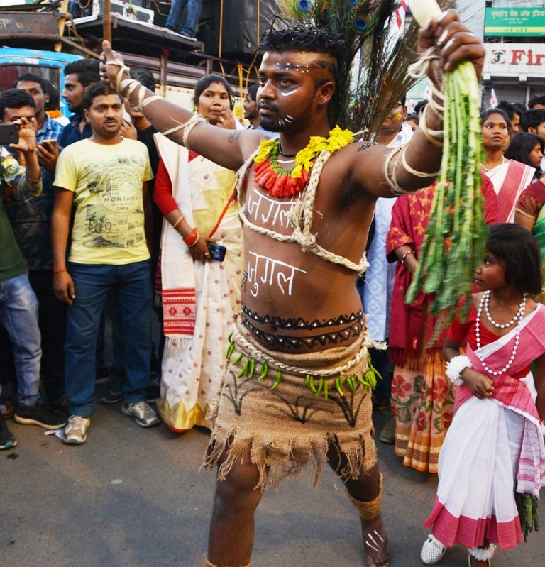 <p>A tribal youth dressed up as Jungle King during the Sarhul festival (Sobha Yatra) celebrations in Ranchi on Tuesday.</p>