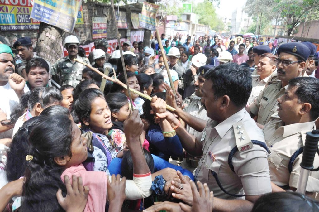"<p>Police personnel trying to stop protesters<strong> </strong>during ""Bharat Bandh"" called given by Dalit organizations against the alleged dilution of SC/ST act, in…"