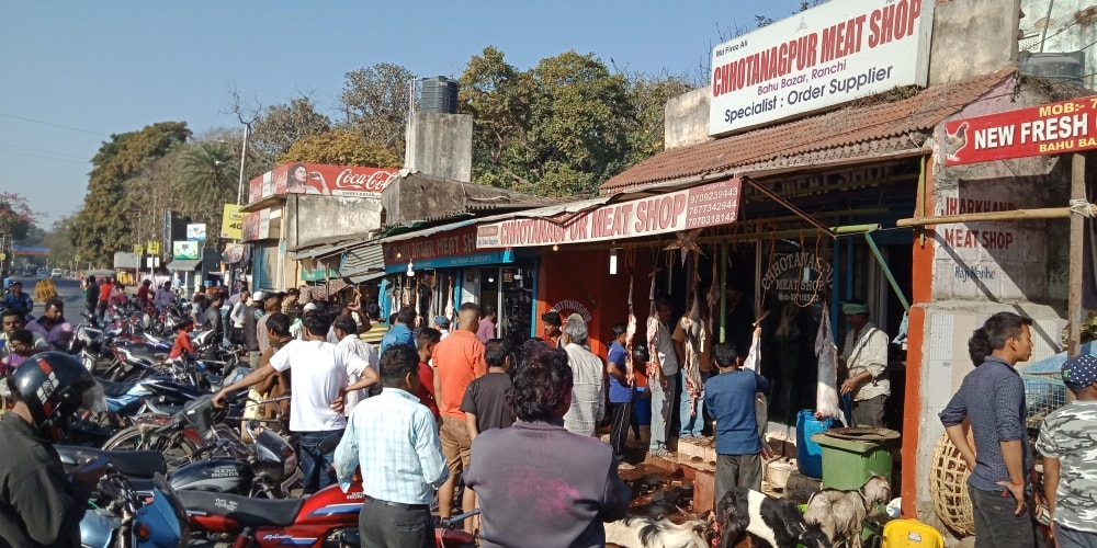 <p>People gather outside meat shop's for buying chicken & Khashi meat at Bahubazar in Ranchi on Friday. </p>