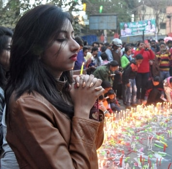 <p>Devotees light candles at All Saint Cathedral Church as they celebrate Christmas festival in Ranchi on Monday. </p>