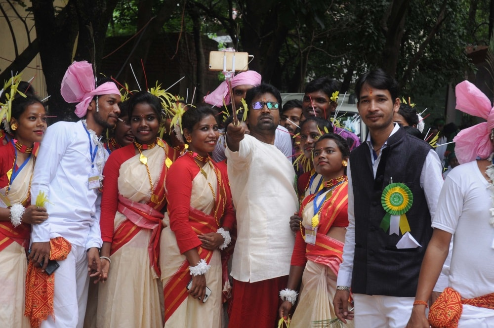 <p>College students participating in Karam festival at Tribal Regional Language department, Ranchi pose for a selfie.</p>