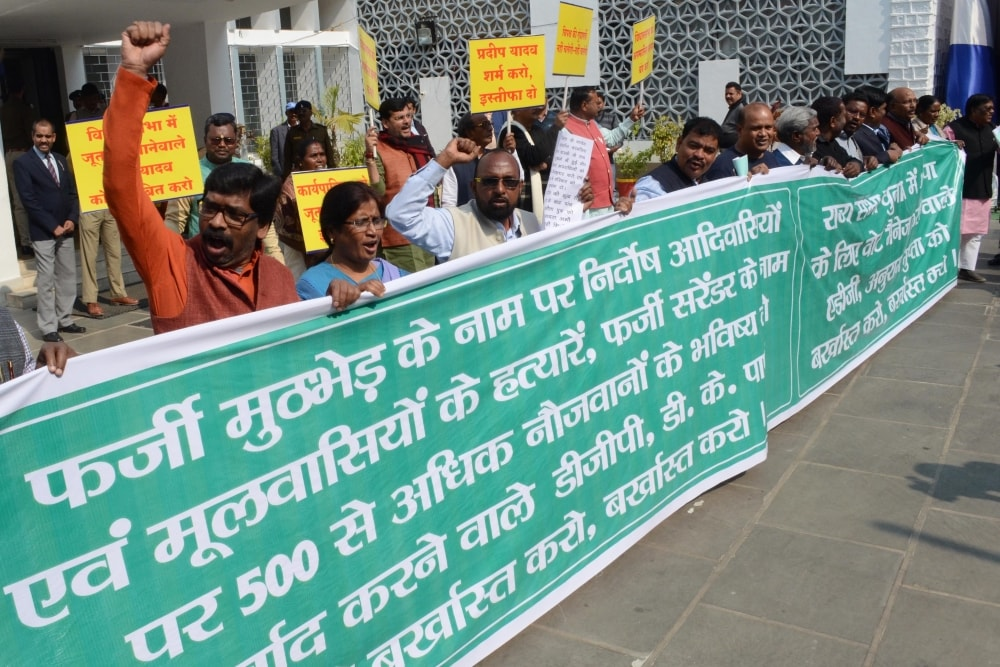 <p>BJP legislators protest in front of Jharkhand Assembly against oppositionlegislators during the ongoing Budget session in Ranchi on Wednesday.</p>