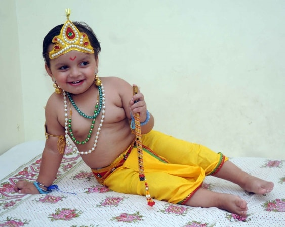 <p>A child dressed as the Lord Krishna during a competition as part of Krishna Janmashtami celebrations in Ranchi on monday.</p>