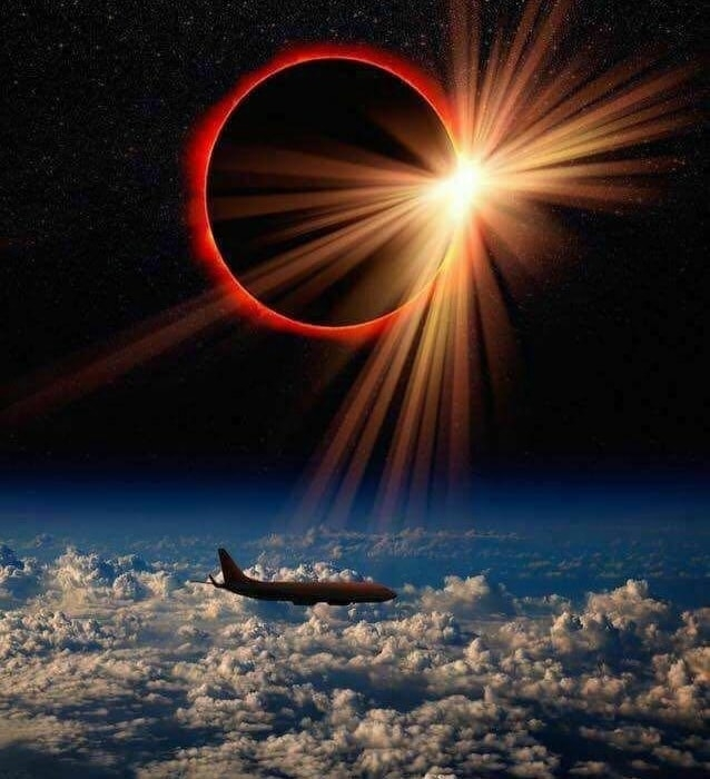 <p>A British Airways pilot clicked this photo of a solar eclipse when his plane was crossing the Atlantic ocean. One can see another plane on the same flight.</p>