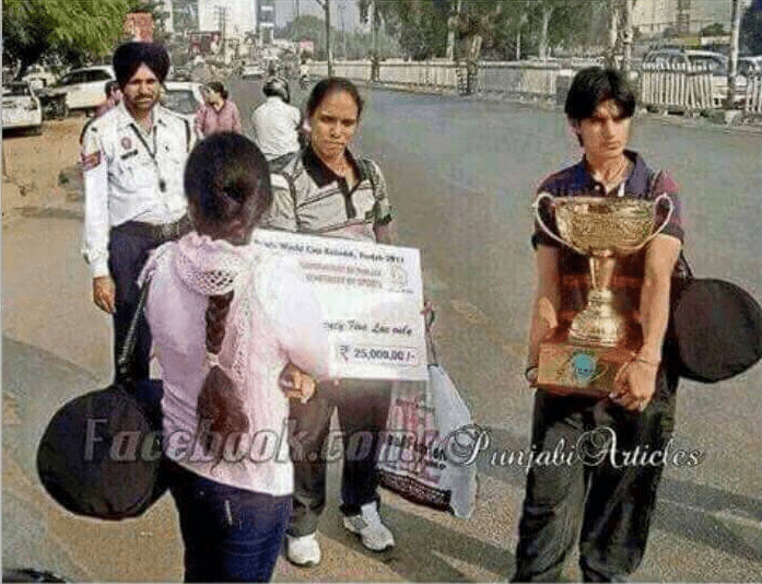 <p>World Cup Kabbadi Champion players waiting to get a three wheeler to move to reach home with Momento in their hands.Proud of them that they are Indians and yet it is a national…