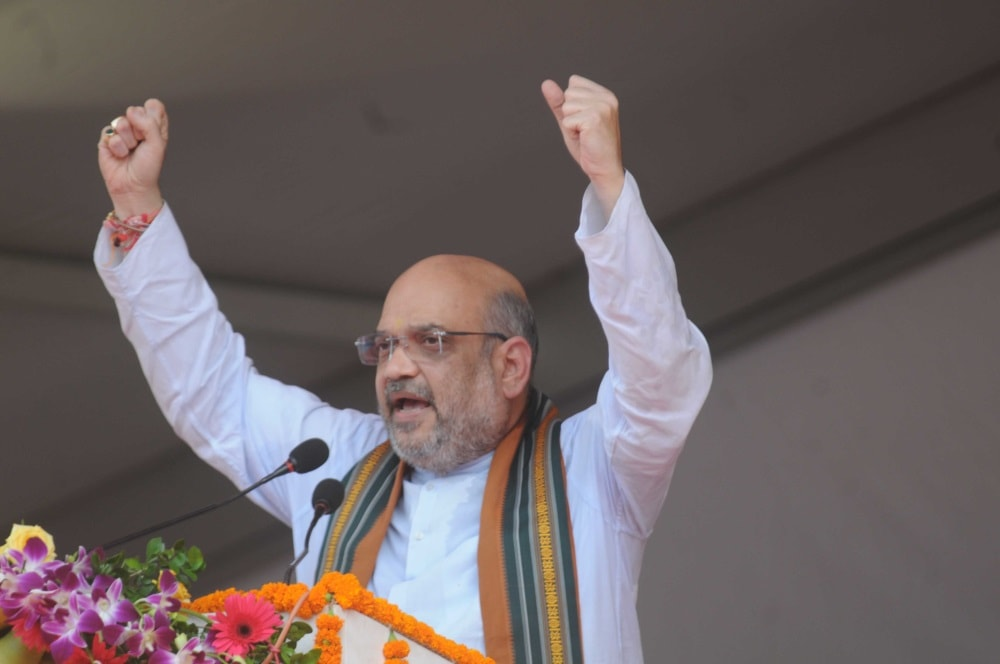 "<p>BJP National President Amit Shah addresses a gathering during ""Garib Kalyan Mela"" on 1000 days achievements of Government of Jharkhand during a programme in Ranchi on…"