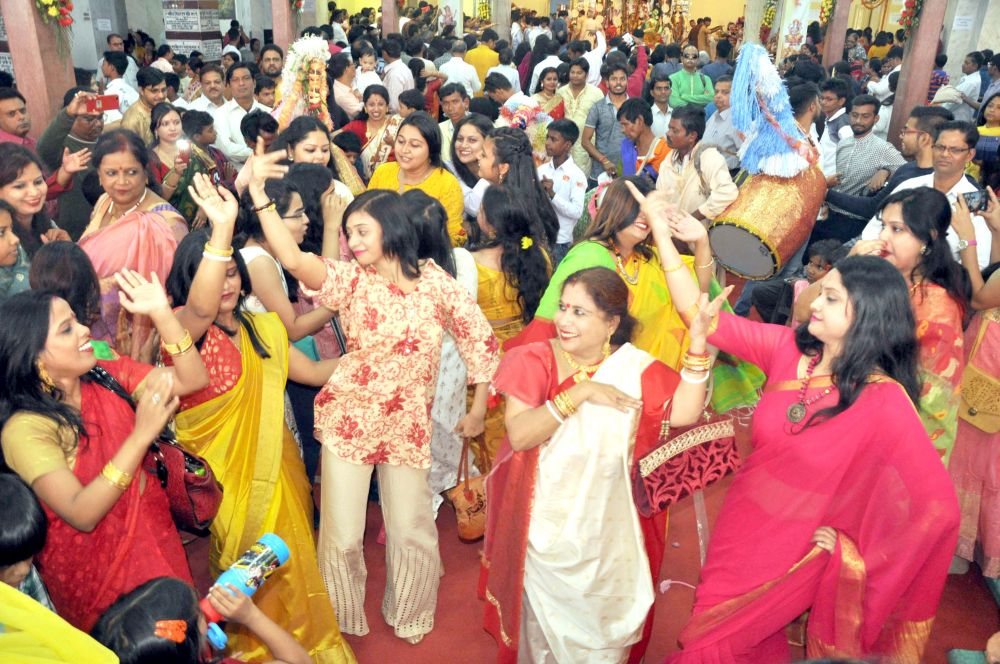 <p>Devotees celebrate at Durga Bati Puja pandal on the occasion of Maha Ashtmi during the ongoing Durga Puja festival at Albert Ekka Chowk in Ranchi on Wednesday.</p>