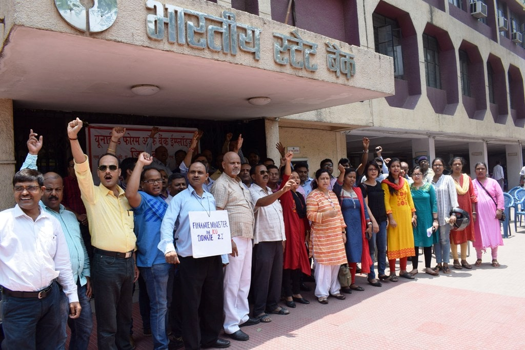<p>Bank employees hold a demonstration as a part of their two-day nationwide strike to press for wage revision, in Ranchi on Wednesday.</p>