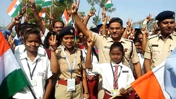 <p>Ranchi Senior Superintendent of Police (SSP) Kuldeep Dwevadi along with Naxal effected children sign victory out side JSCA stadium during India VS Australia's 2st day of third…