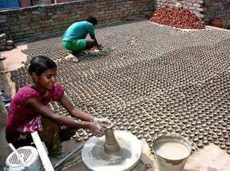 <p>Potters are busy preparing Diyas for the festival of light-Dipawali.</p>
