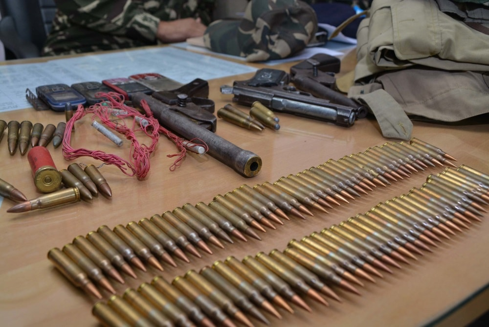 <p>Police personnel showing ammunitions and weapons after recovering from CPI Maoists during a press conference in Ranchi on Tuesday.</p>