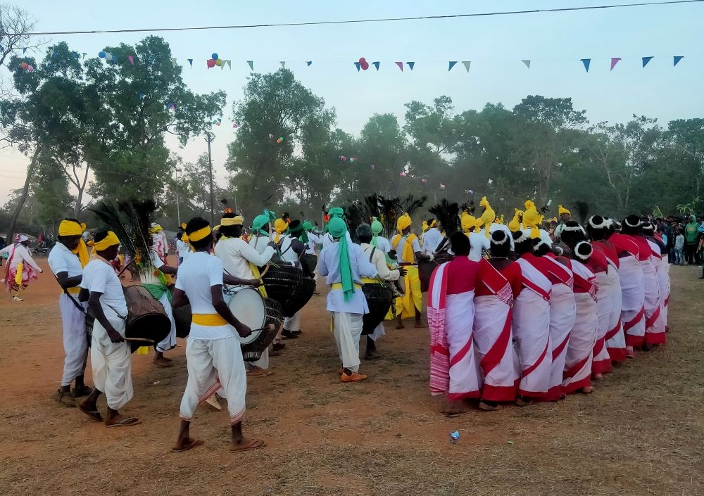 <p>Dancers from various tribal dance troupes perform traditional dance on the occasion of 'Mage Buru' at Tirla village of Khunti district. 'Mage Buru' a village…