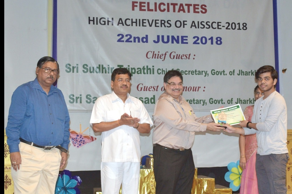 <p>A student receives High Achievers of AISSCE-2018 award from Chief Secretary Sudhir Tripathi during a programme at DPS school premises in Ranchi on Friday.  State Law Secretary…