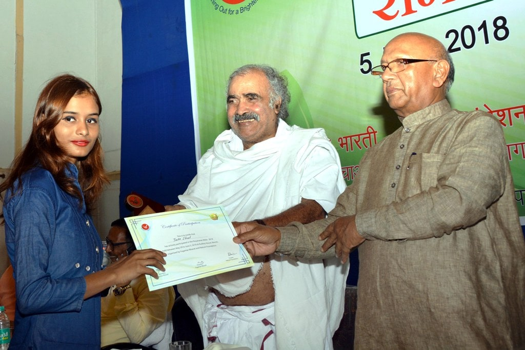 <p>President of Damodar Bachao Andolan and Food Public Distribution Minister Saryu Roy along with Secretary Vikas Bharti and Padam Shri recipient Ashok Bhagat presenting a certificate…