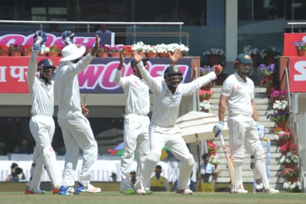 <p>Indian players celebrate the wicket of Australia's Shawn Marsh during their third Test match at Jharkhand State Cricket Association's International Stadium in Ranchi. After…