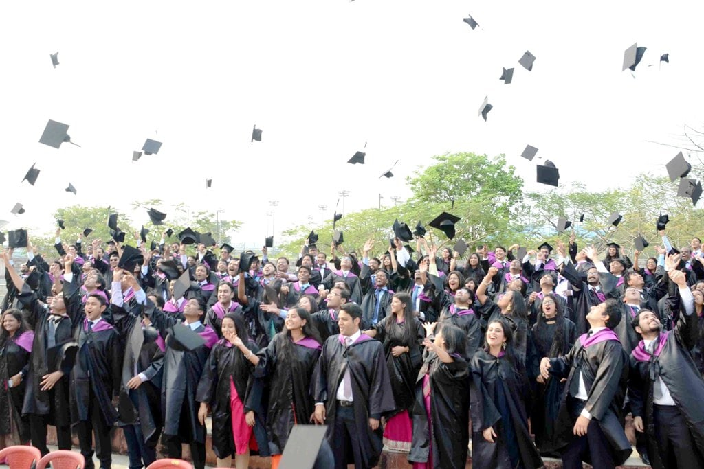 <p>Jubilant students toss their hats after receiving their degree and medals during the 7th Convocation-2018 of Indian Institute of Management (IIM) at Khelgaon in Ranchi on Thursday. </p>…