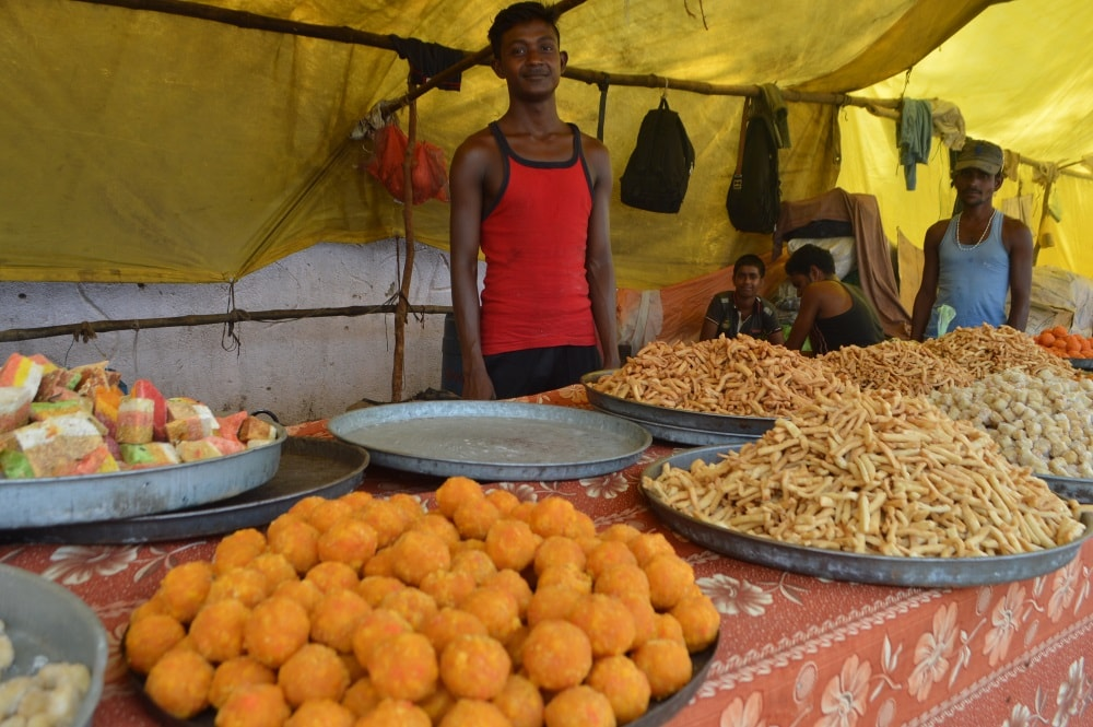 <p>Hand cooked sweets especially Ladoos are selling near Jagannath temple site-venue of Rath Yatra.</p>