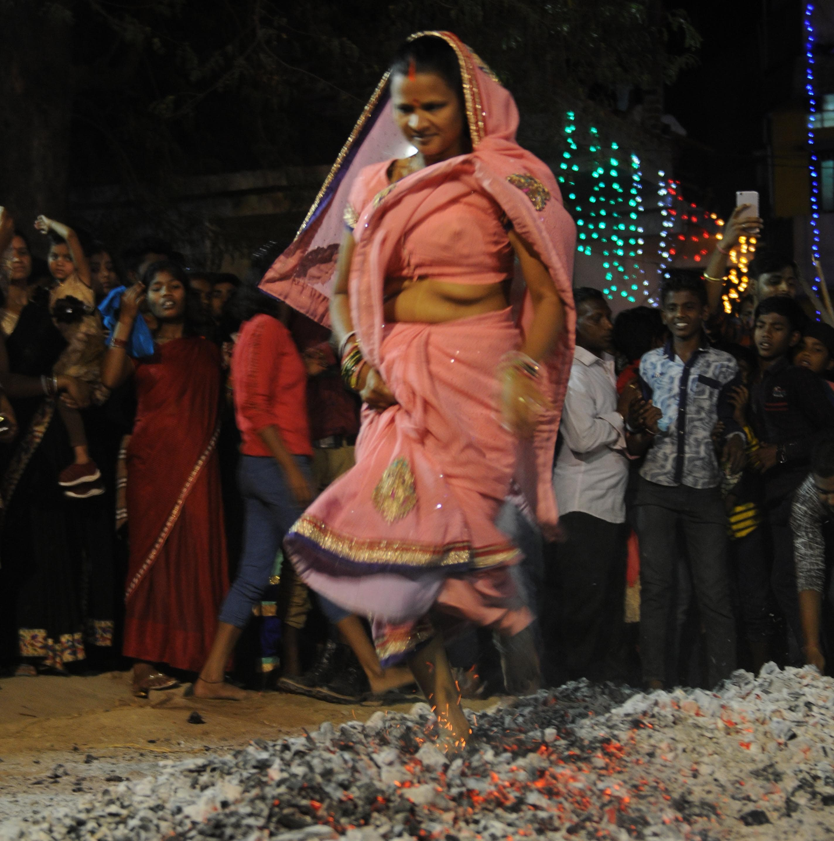 <p>A tribal devotee walks on burning coal to pay tribute to Lord Shiva during Manda festival in Ranchi on Saturday early morning. </p>