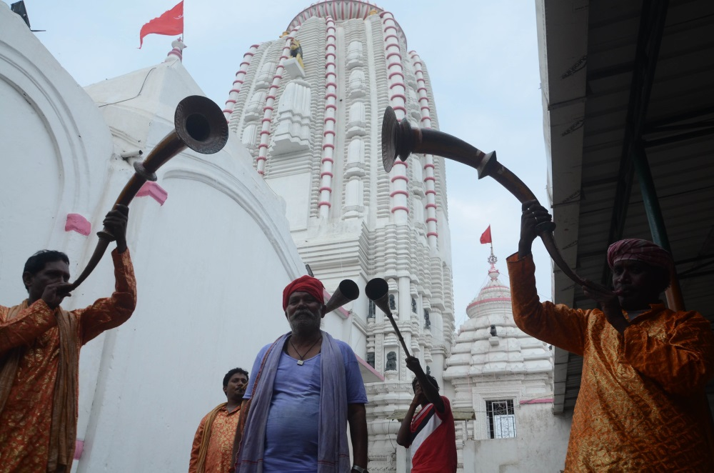 <p>Temple priests blow trumpets on the occasion of Rath Yatra festival at Jagannathpur in Ranchi on Saturday.</p>