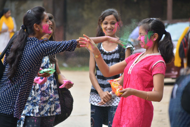 <p>Scores of students of the Ranchi Women's college played Holi by exchanging colour powder ahead of Holi festival in Ranchi on Friday.</p>